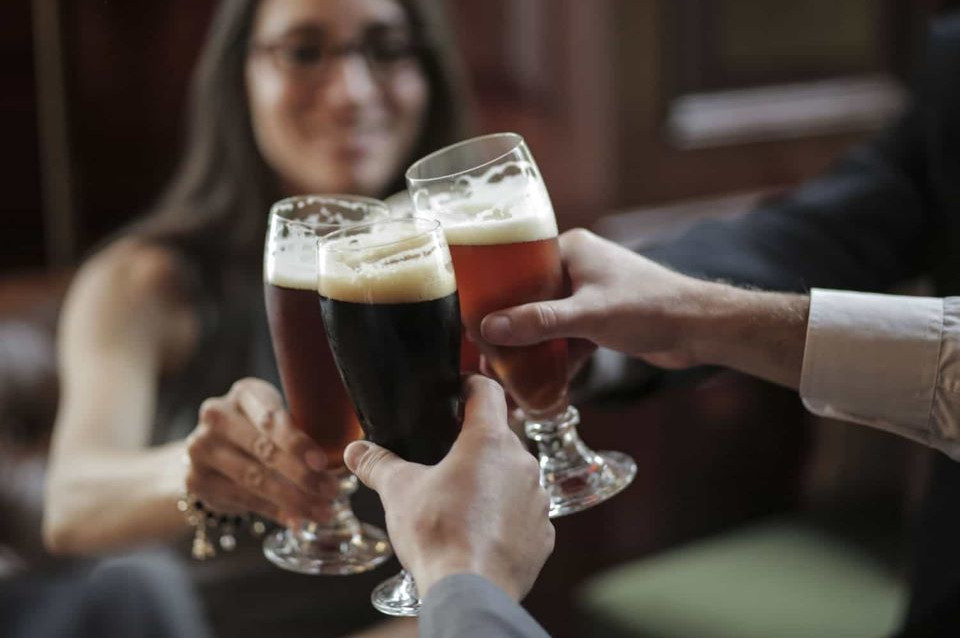 Guests drinking beer in Casa Gangotena's bar.