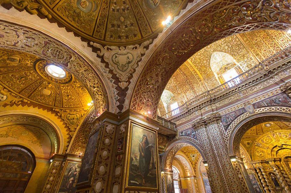 The interior of La Compañía de Jesús church in downtown Quito.