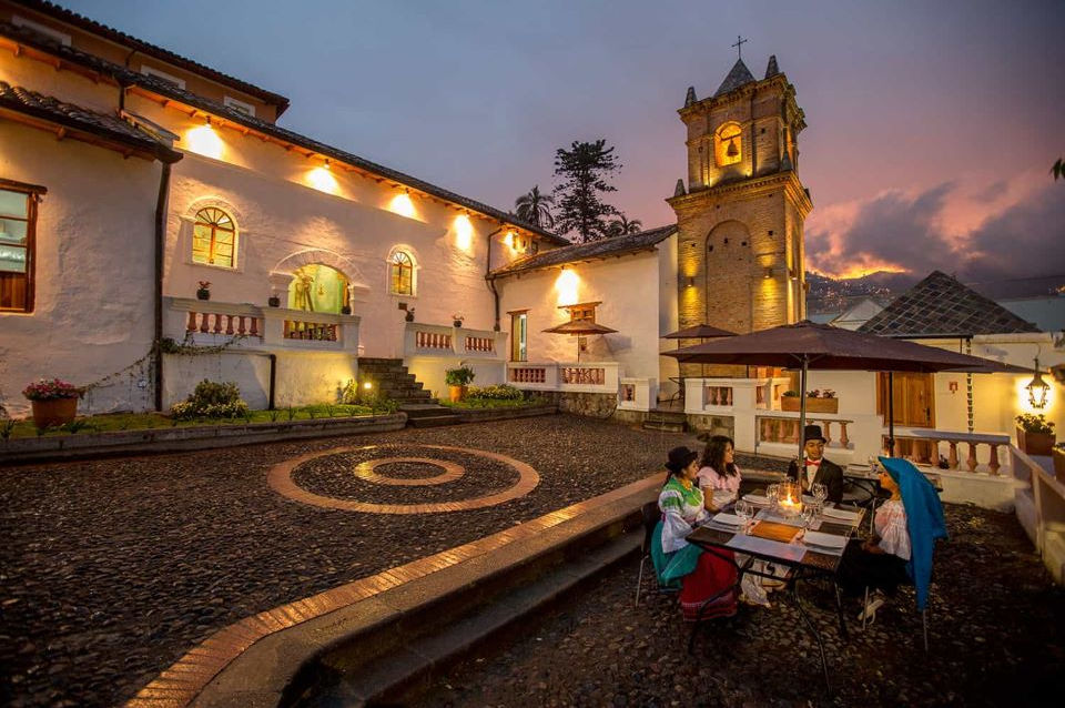 the Chapel of Miracles in Quito's old town at night.