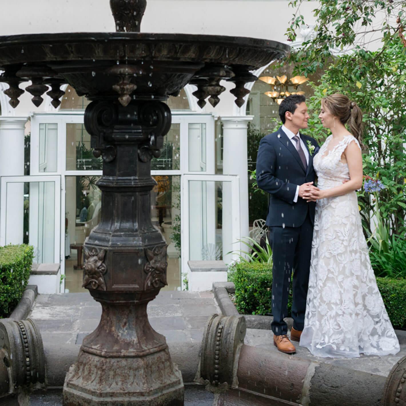 Newlyweds take photos in Casa Gangotena's outdoor courtyard.