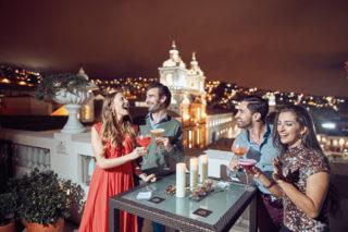 Night view of Casa Gangotena's rooftop terrace