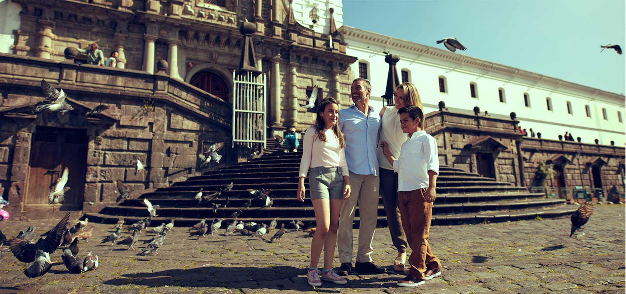 Family at Plaza San Francisco in Quito