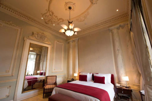 Guest rooms' high ceilings and elegant interiors